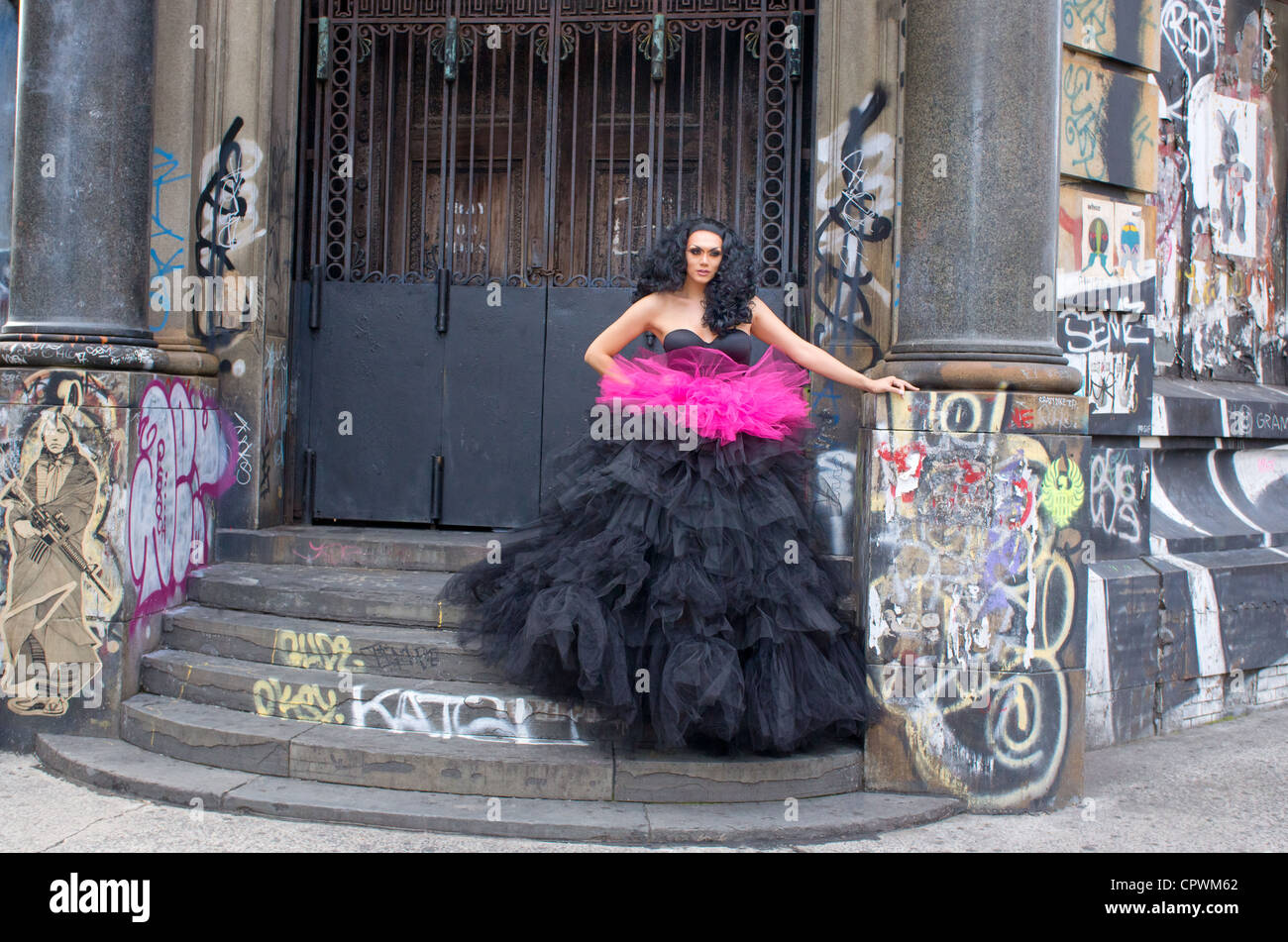 model-in-evening-dress-poses-in-front-of