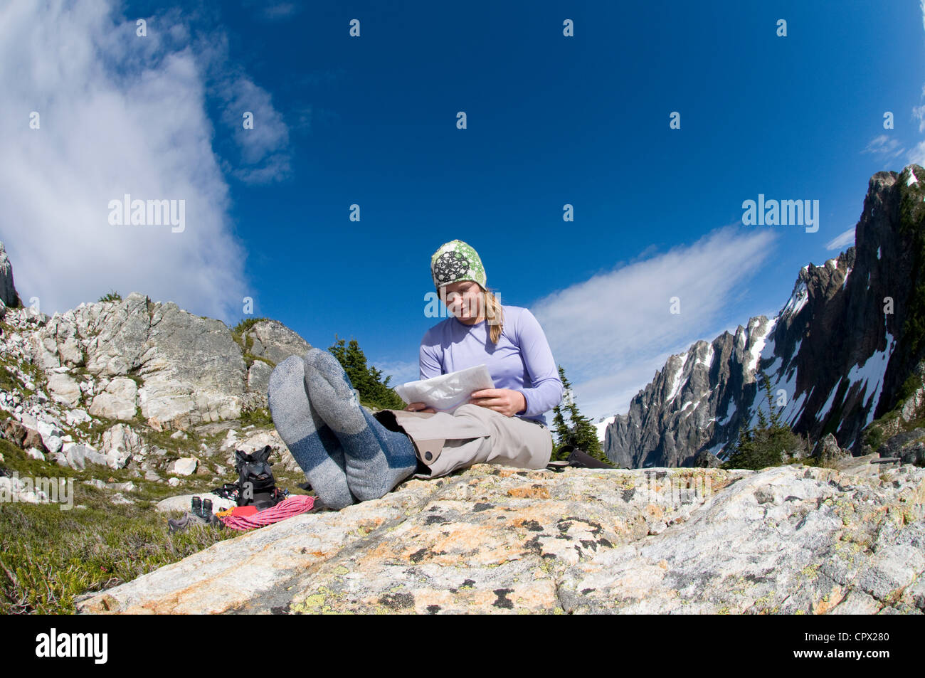Woman reading map at camp Picket Pass North Cascades National Park