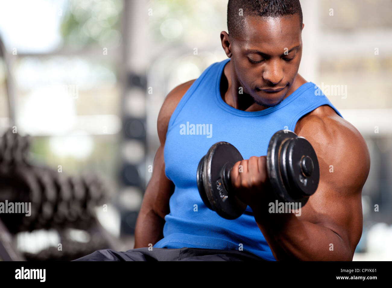 Young muscular black man lifting weights in a gym Stock ...