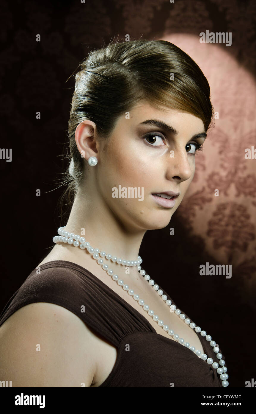 Stock Photo  Young Woman Wearing A Pearl Necklace And Pearl Earrings,  Portrait