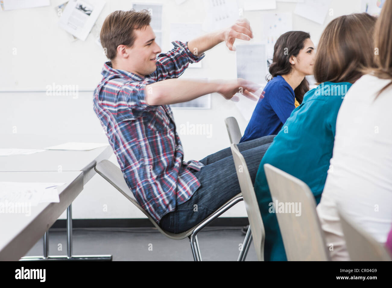 Student Tilting Chair Back In Class