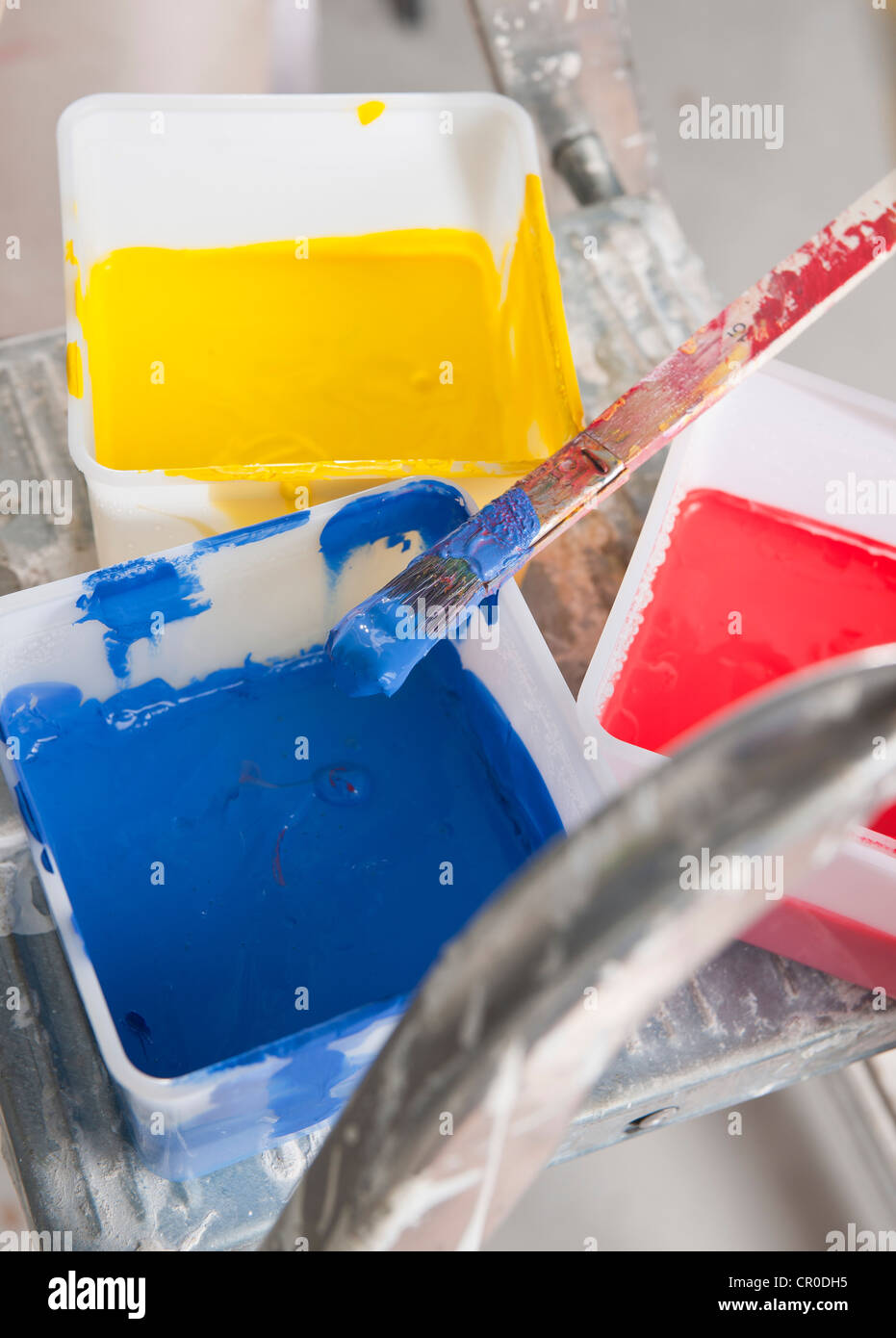 Tubs of paint on the step of a ladder Stock Photo, Royalty Free ...