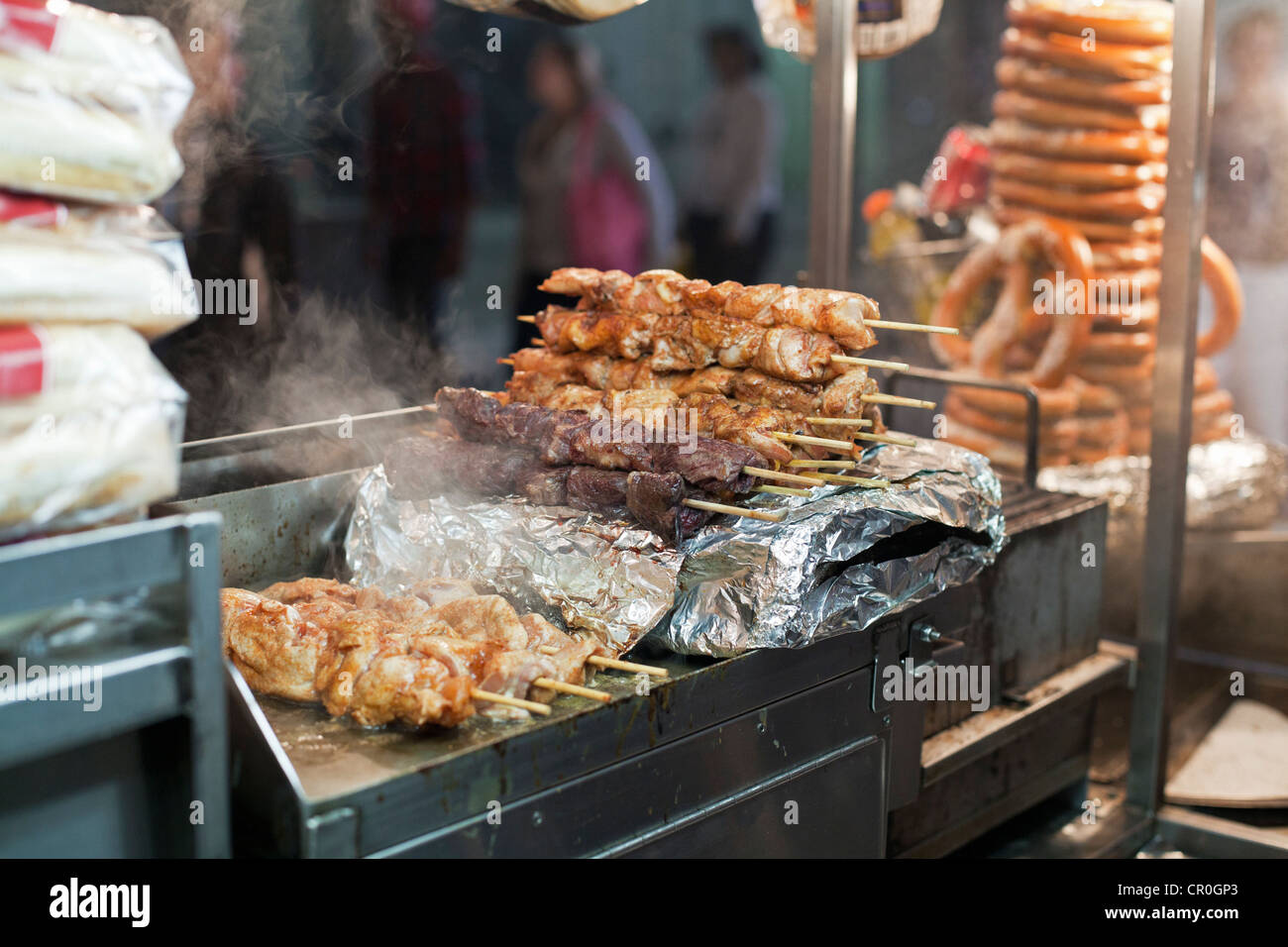 A Food Vendor Truck Serves Up Grilled Shish Kebab At Night In New York City