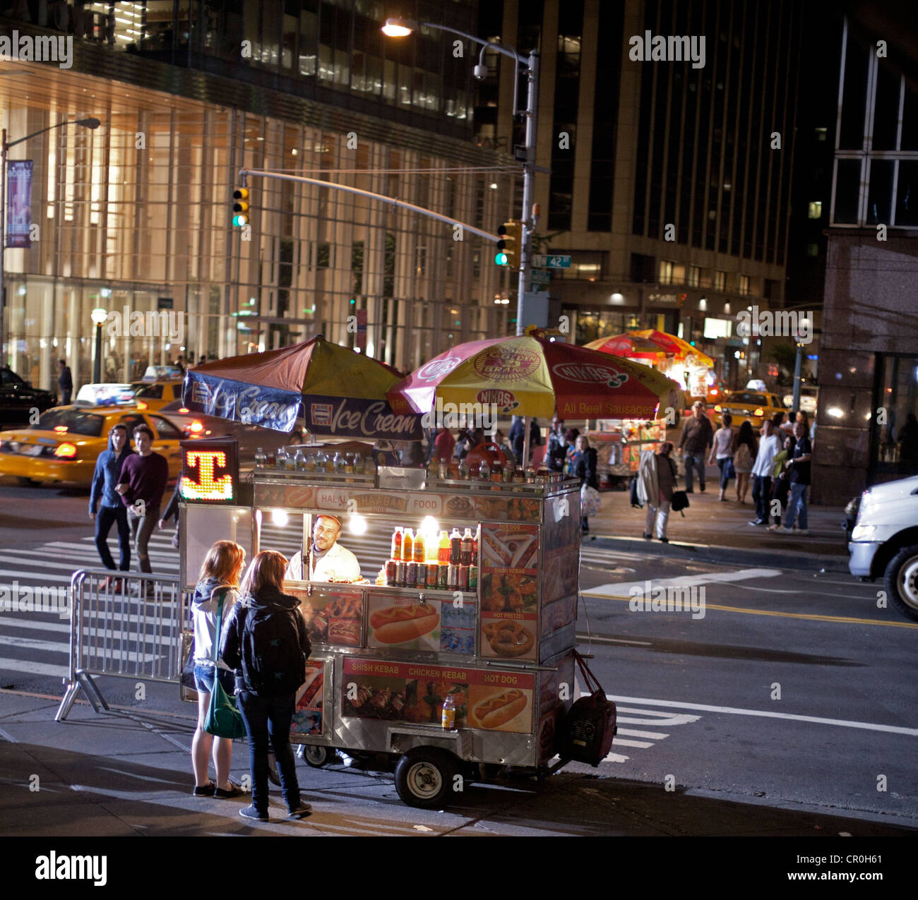 A food truck is open late at night in New York City Stock ...