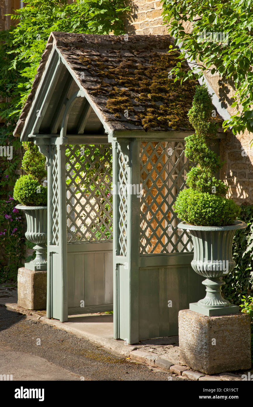 Wooden Porch With Lattice Sides Of Cotswold Cottage