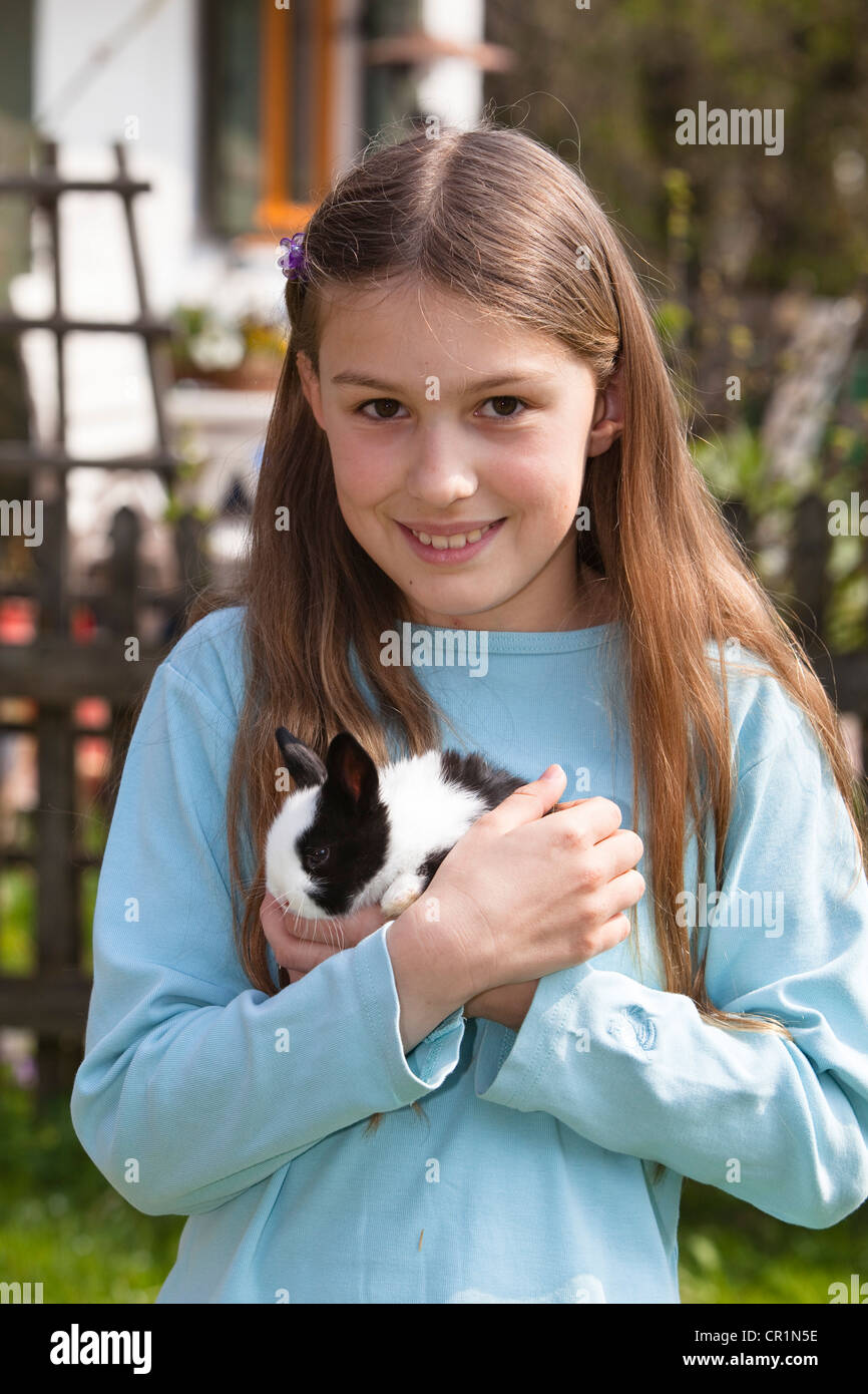 Girl, 10 Years Old, With Pet Rabbit Stock Photo, Royalty