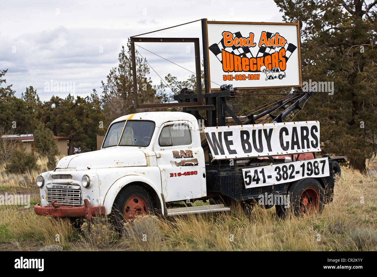 An ancient Dodge truck is used to advertise an auto junk yard in ...
