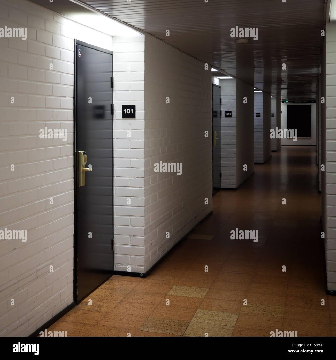 Abstract dark hotel corridor interior with doors and room numbers & Abstract dark hotel corridor interior with doors and room numbers ... pezcame.com