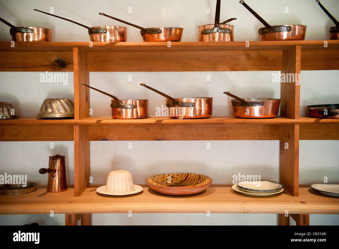 shelves of copper pots and pans in a kitchen on thomas monticello estate in - Copper Pots