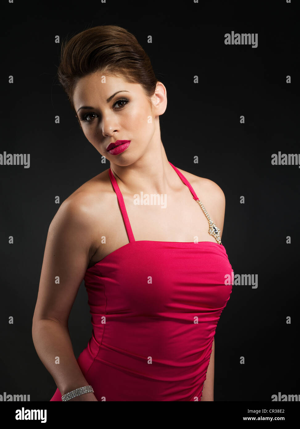 Beautiful woman in pink / red cocktail dress Stock Photo, Royalty ...