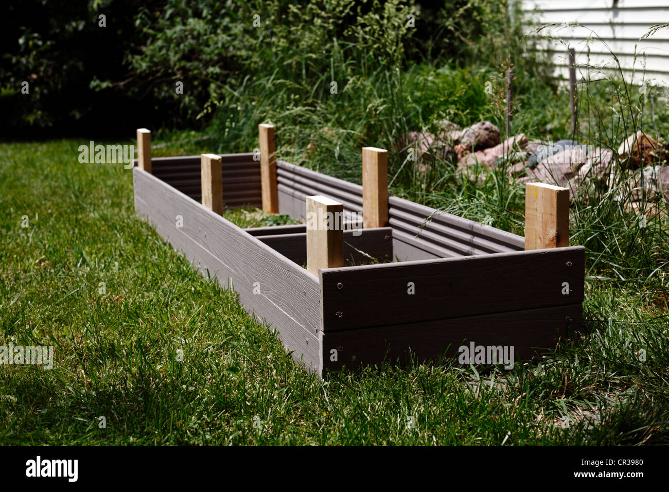 Homemade Composite Lumber Garden Planter Box, Upside Down, Displaying  Corner Stakes.