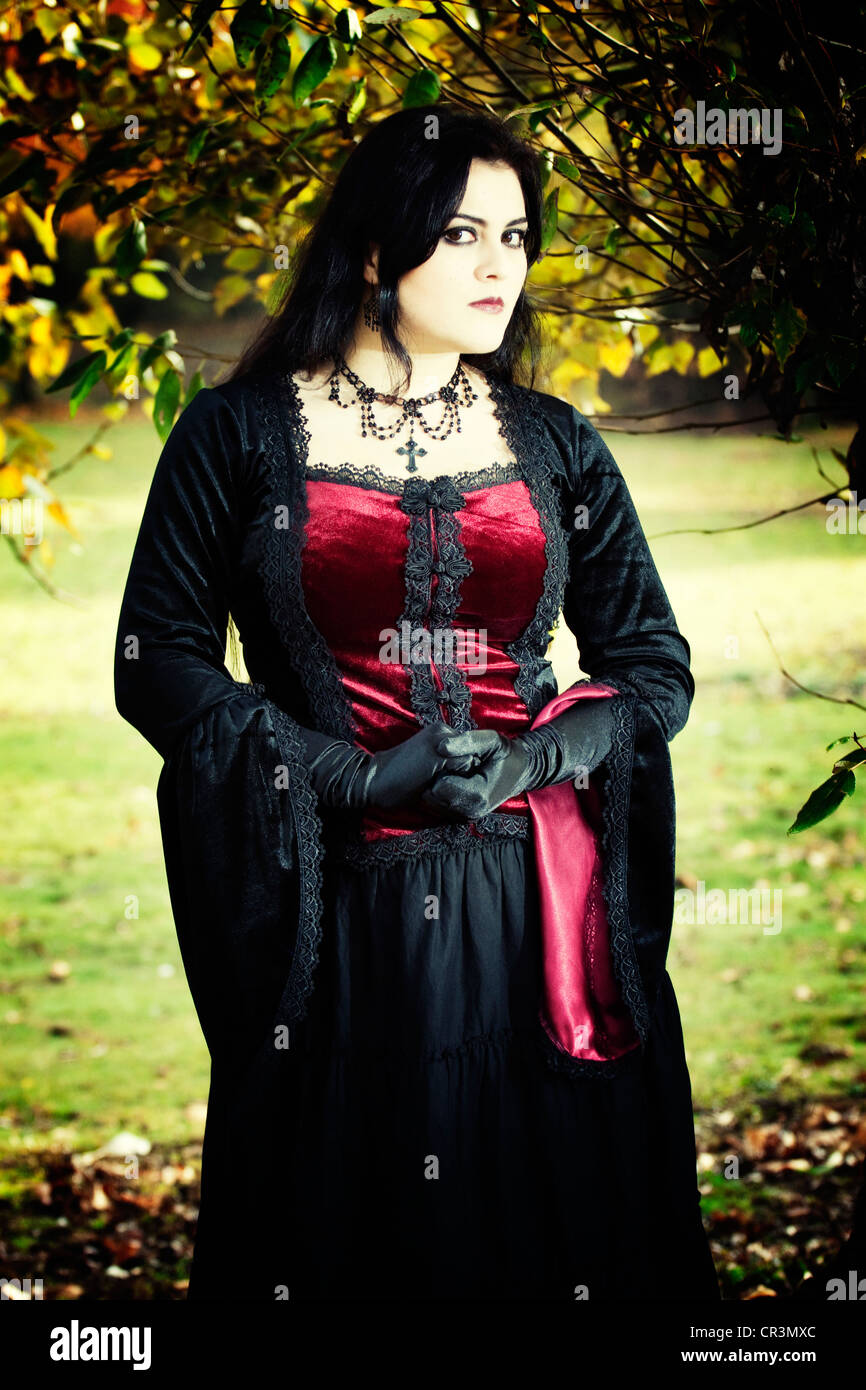 Woman Dressed In A Gothic Style Romantic Standing Looking Serious