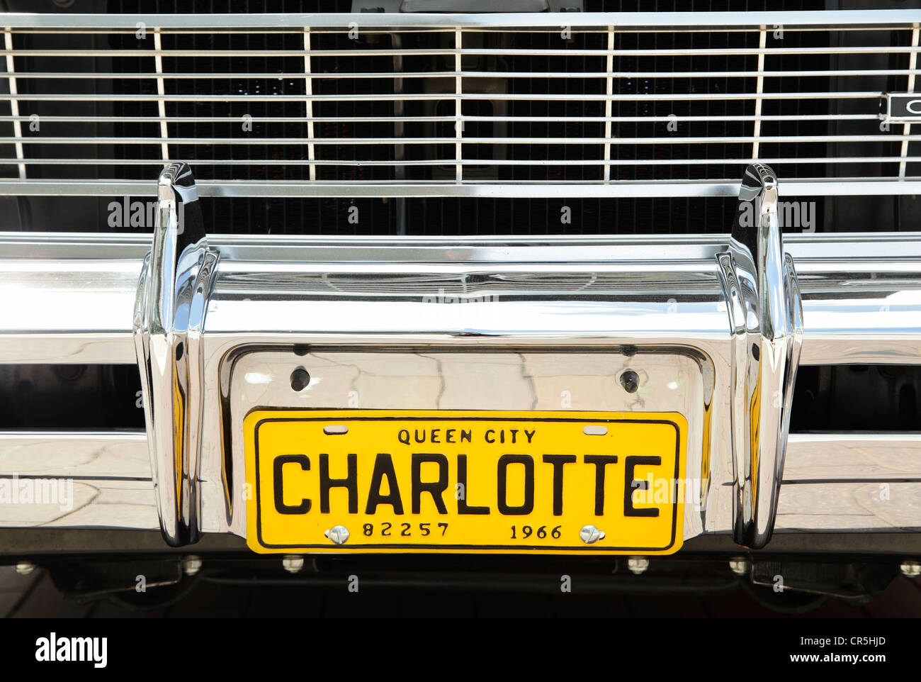 A 1966 Charlotte city tag on the front bumper of a vintage car in ...