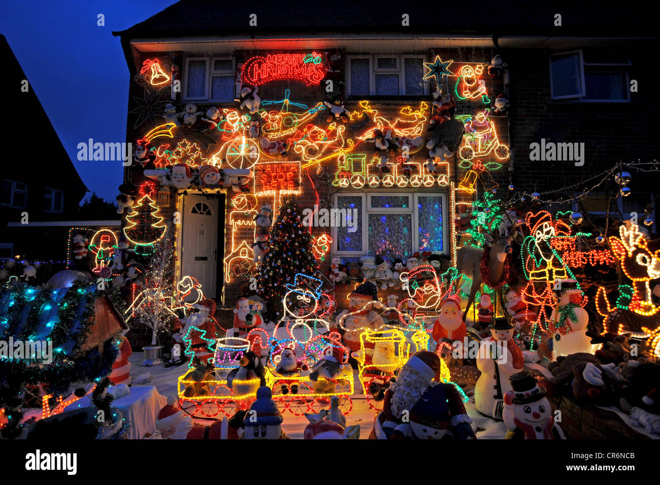 Hundreds of Christmas lights decorate the outside of a house in ...