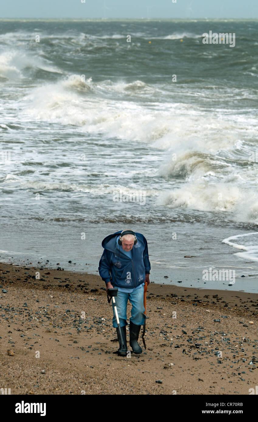 Jew Detector: An Elderly Man Beachcombing With A Metal Detector On