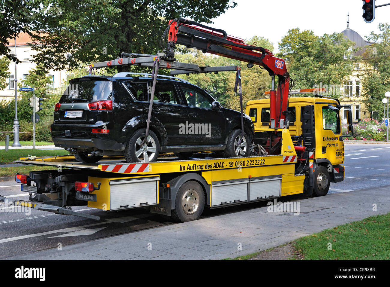Car on a tow truck munich bavaria germany europe stock image