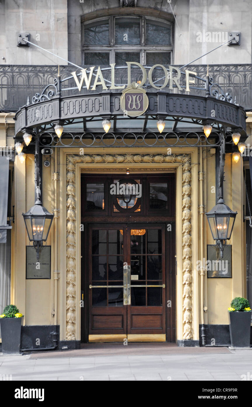 Entrance doors and canopy sign at the Waldorf Hilton Hotel & Entrance doors and canopy sign at the Waldorf Hilton Hotel Stock ...