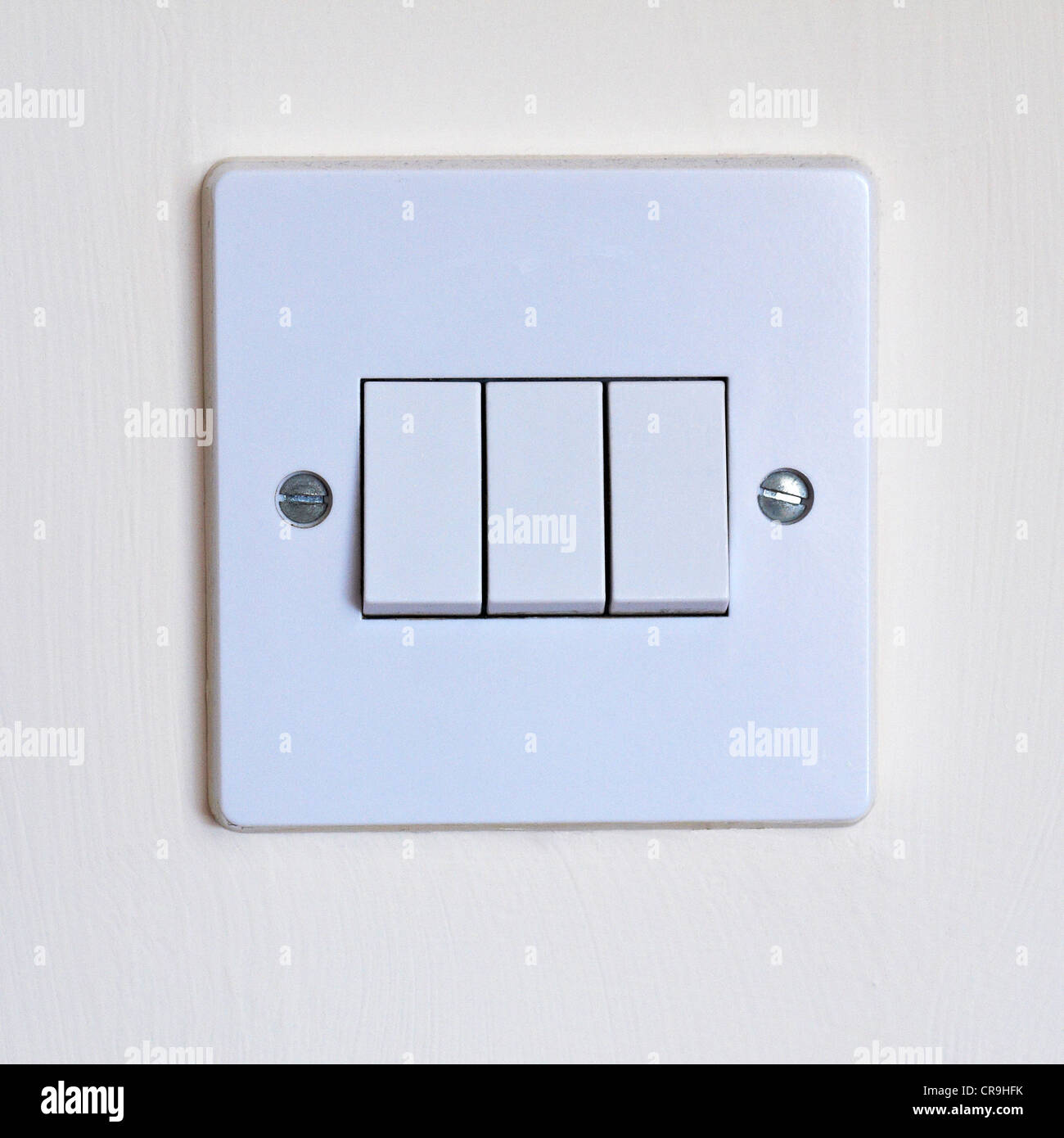 White plastic wall mounted domestic triple light switch Stock Photo, Royalty Free Image ...