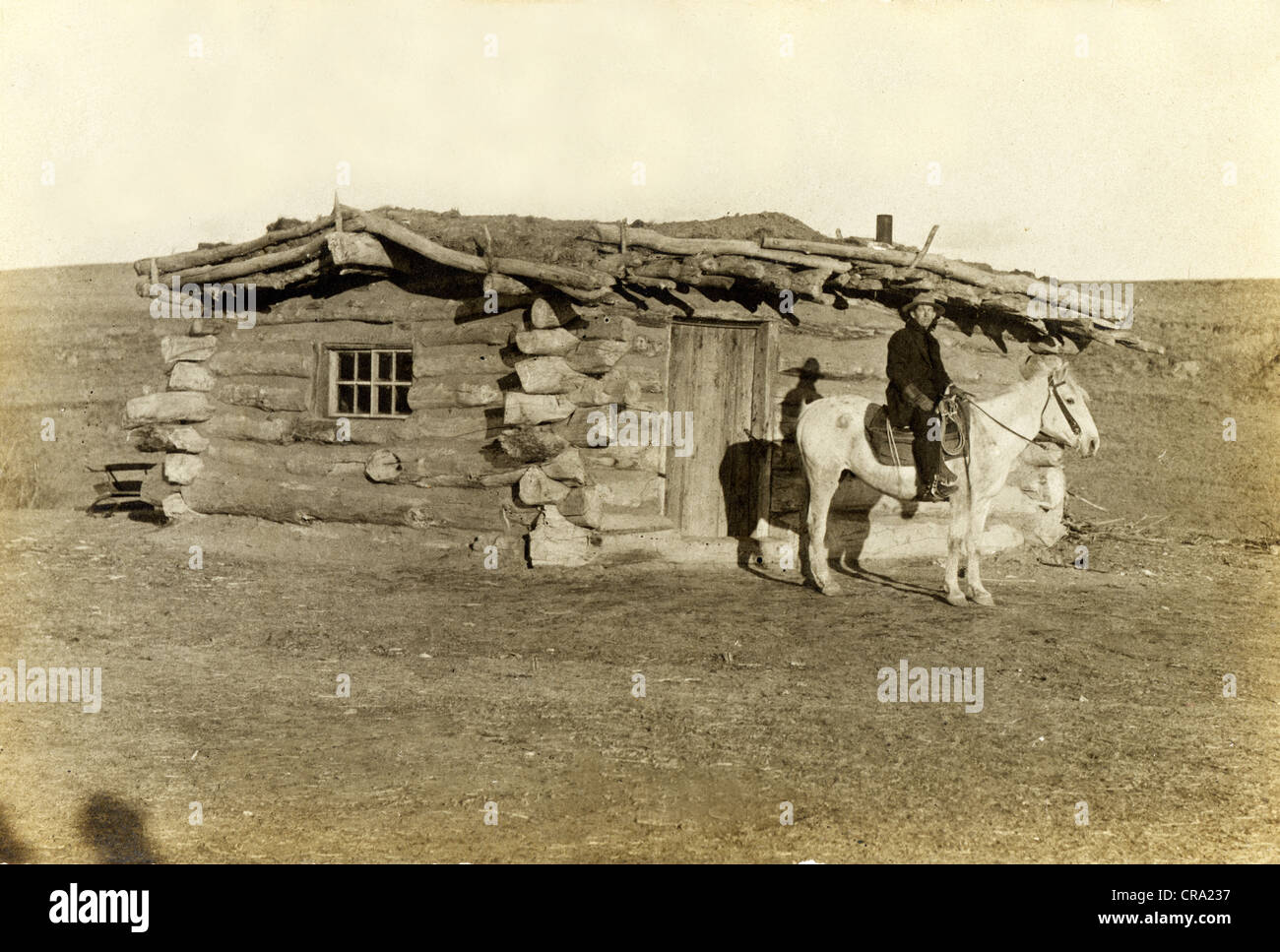Cowboy At Crude Western Log Cabin Stock Photo Royalty