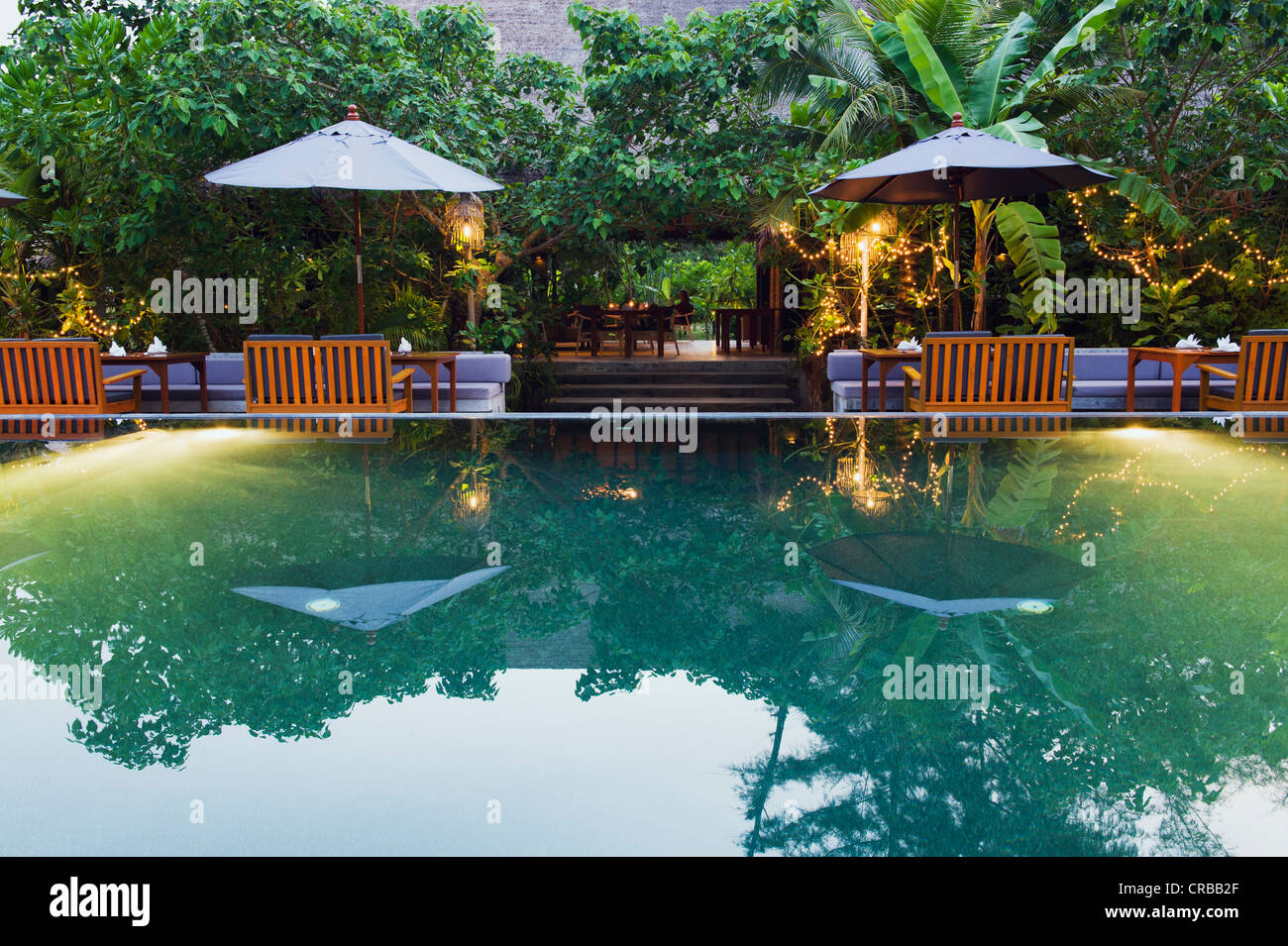 Swimming pool at dusk garden restaurant the sevenseas for Pool garden resort argao