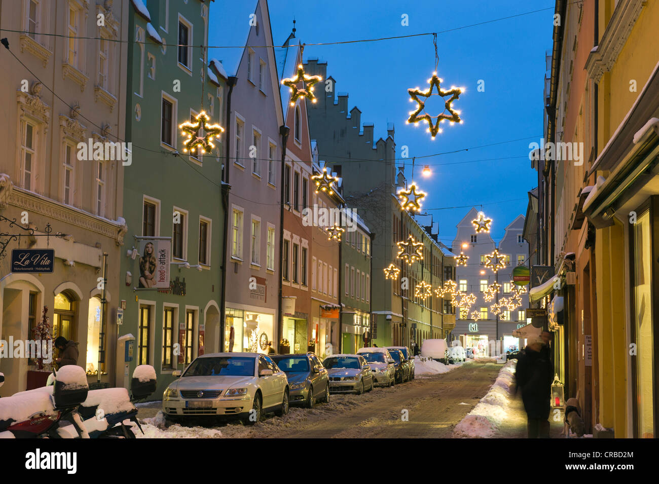 Street with Christmas decorations in winter, Landshut ...