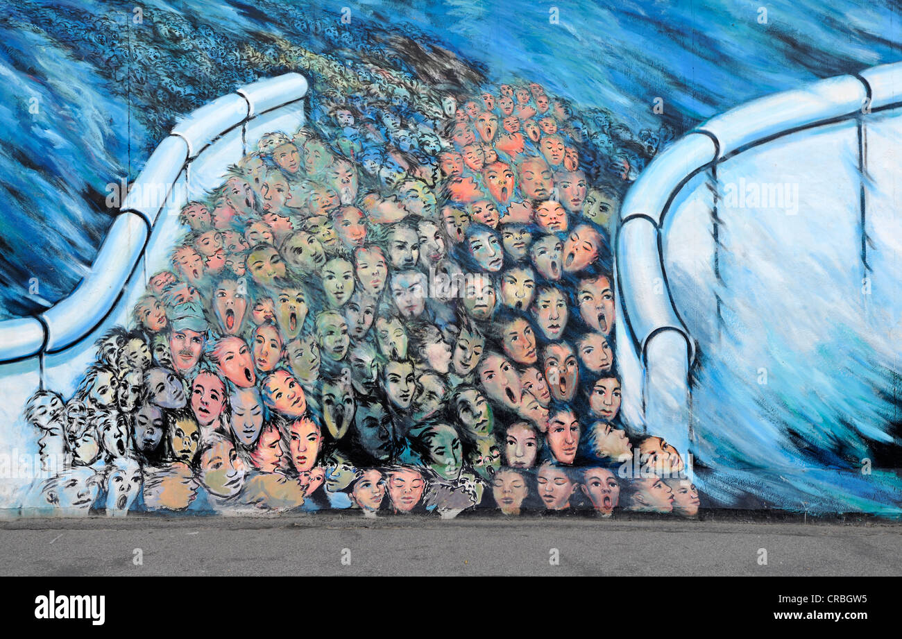 Art and the berlin wall crowds breaking through the for Berlin wall art