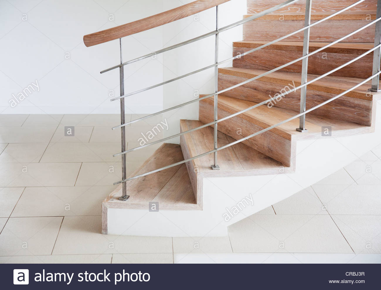Wooden staircase and railing in modern house Stock Photo Royalty