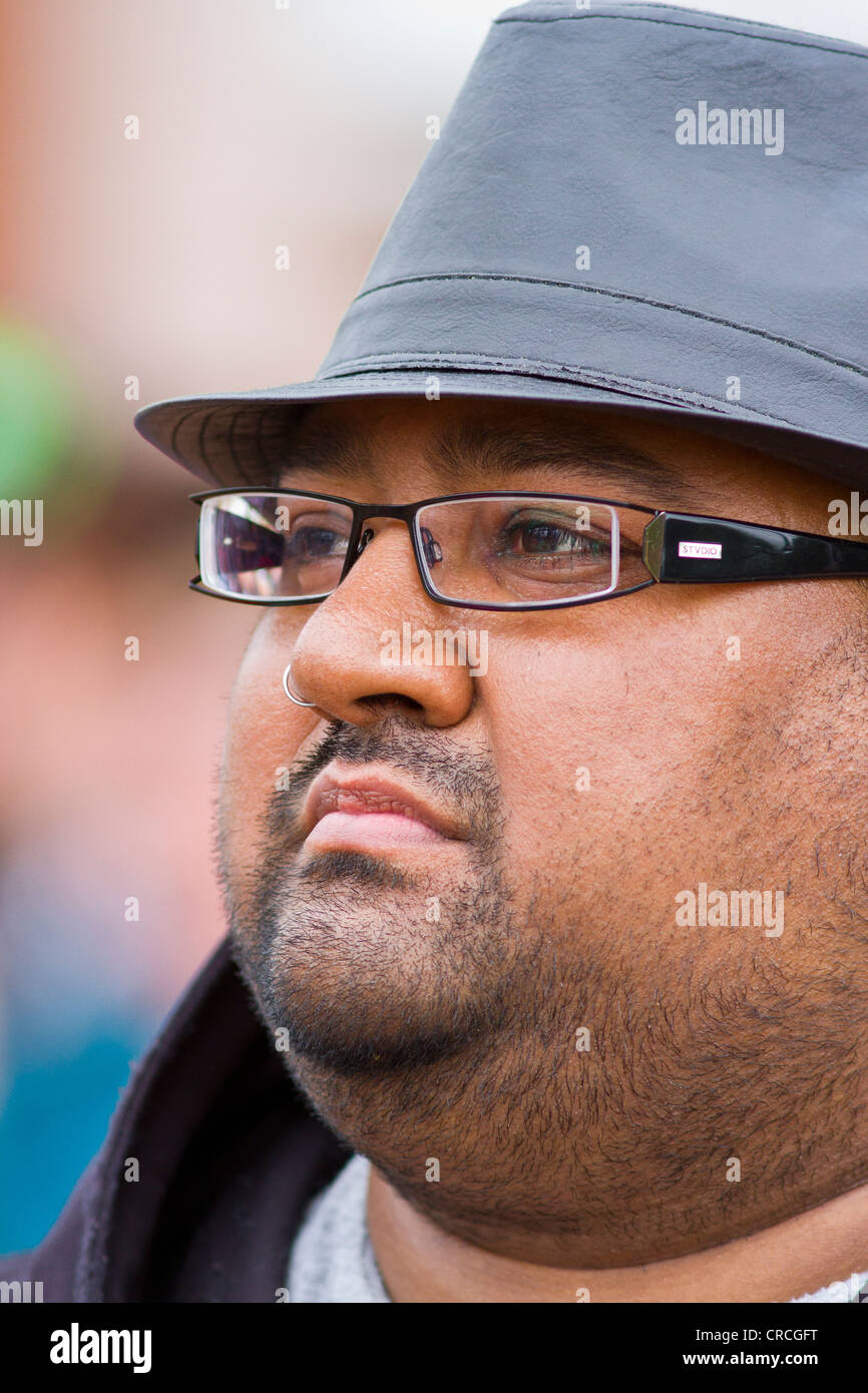 Portrait of Man with trilby, glasses, stubble and nose ring Stock ...