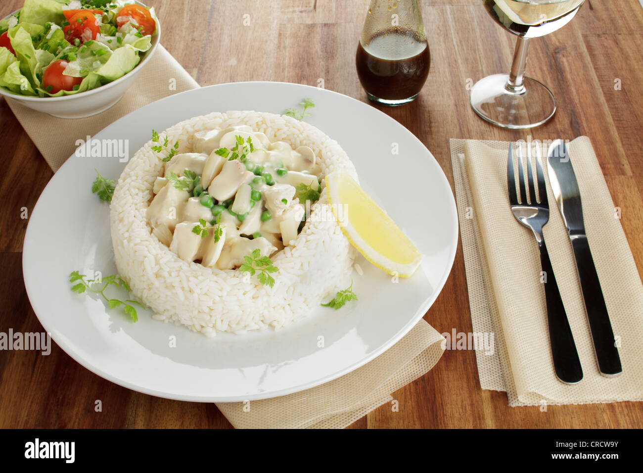 Chicken Fricassee With Asparagus Peas And Mushrooms In A Ring Of Rice Salad