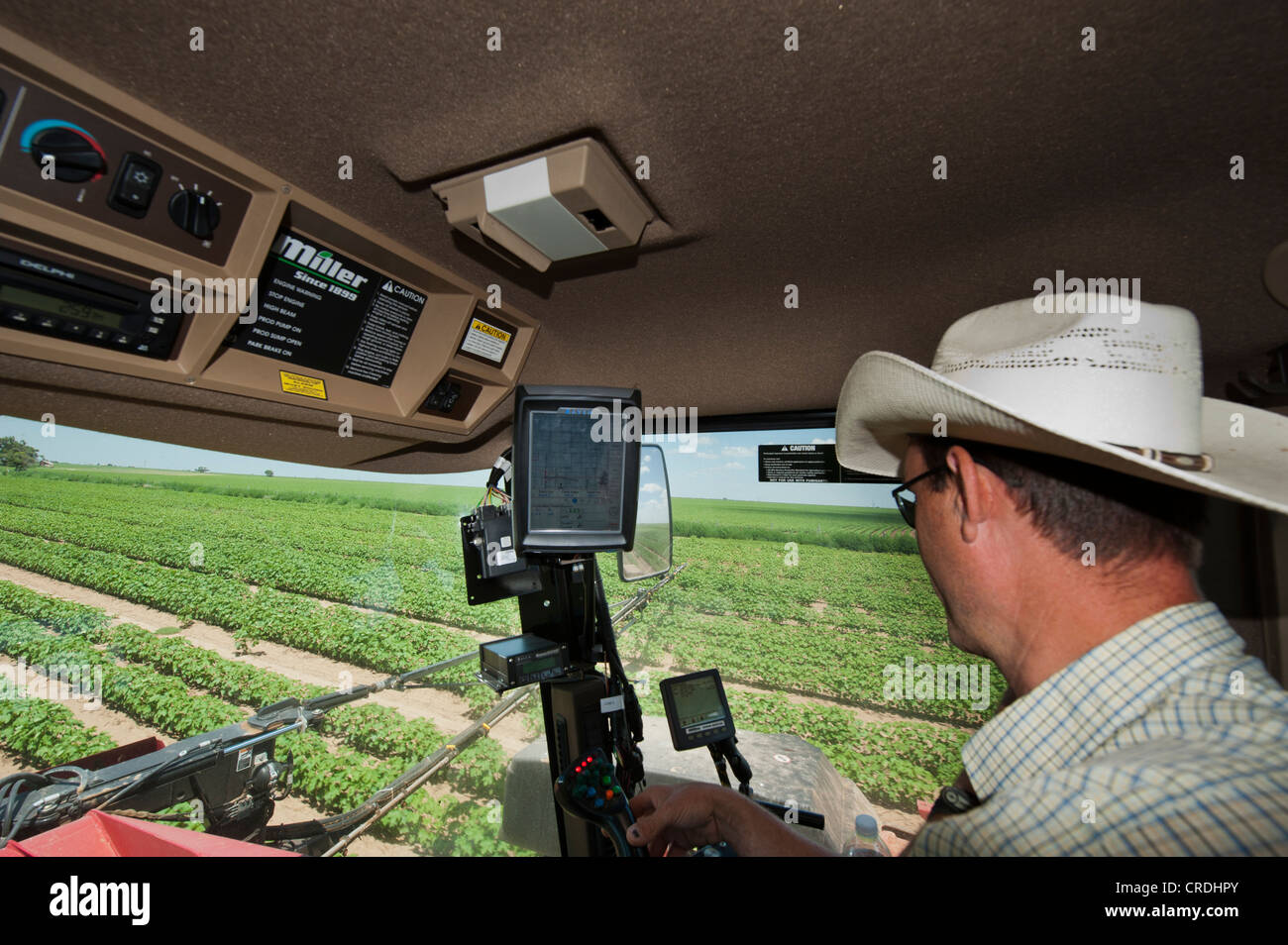 Inside Of A Combine : Farmer inside combine cab using gps and other technology