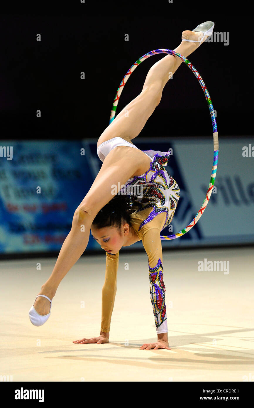 Woman Doing Rhythmic Gymnastics With Hoop Stock Photo