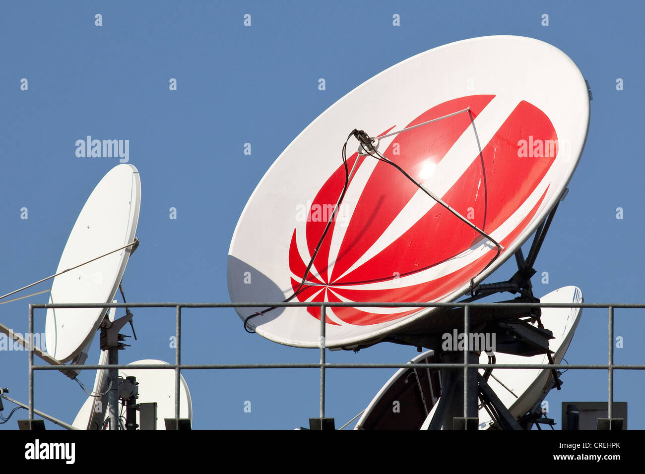 logo of the sat1 tv station on a satellite dish on the