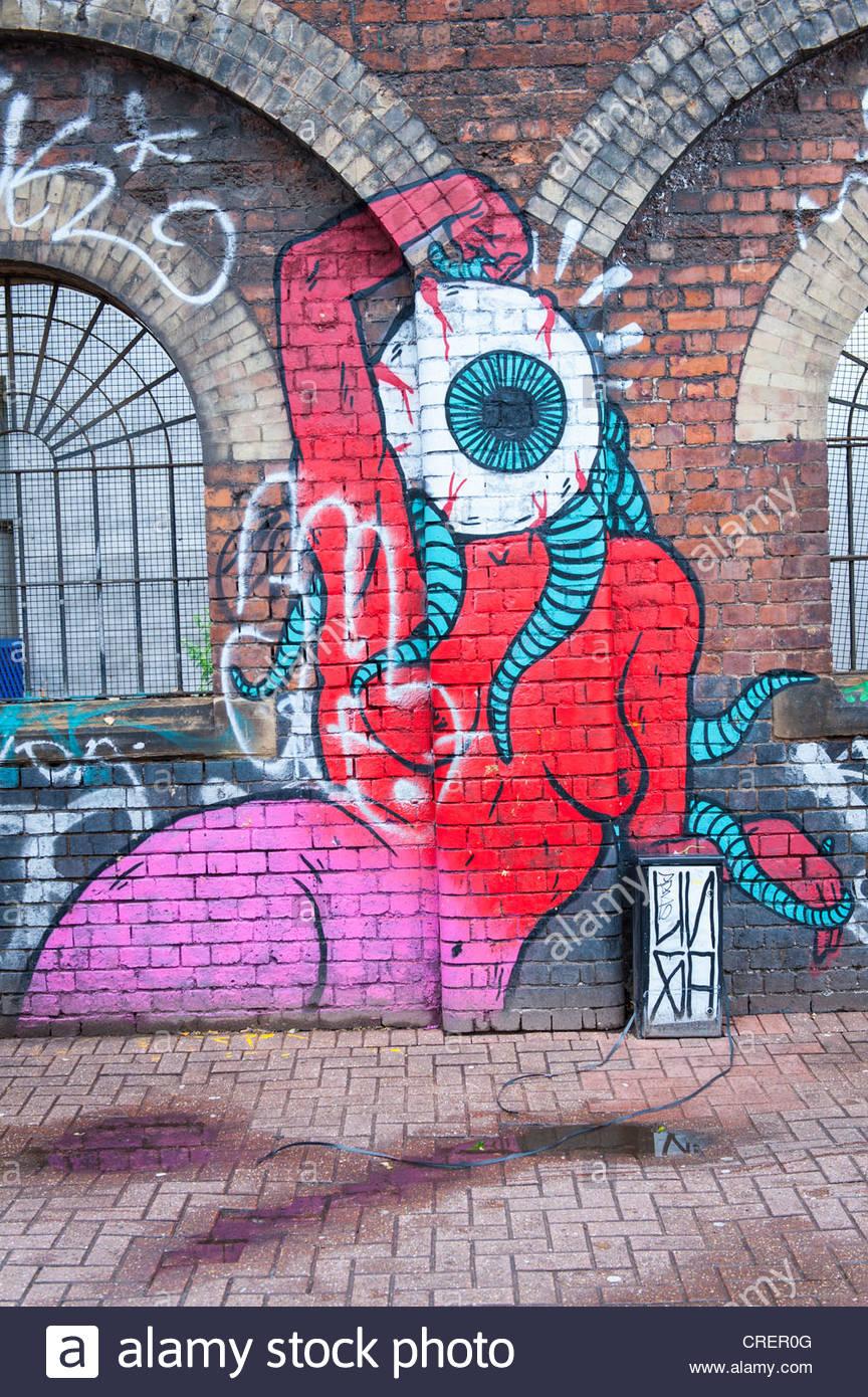 London east end brick lane area graffiti street art for Broken wall mural