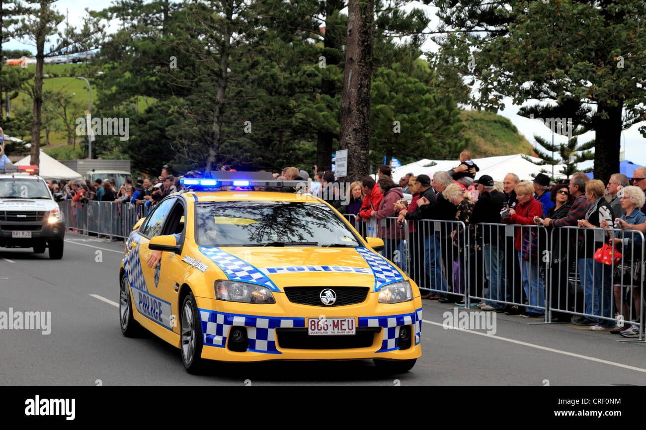 Queensland Police Car Leads The Parade As Crowds Look At