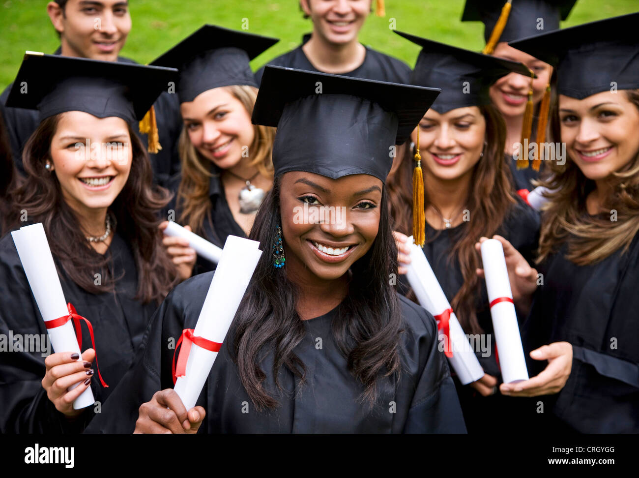group of female graduates gown mortarboard and diploma stock  group of female graduates gown mortarboard and diploma