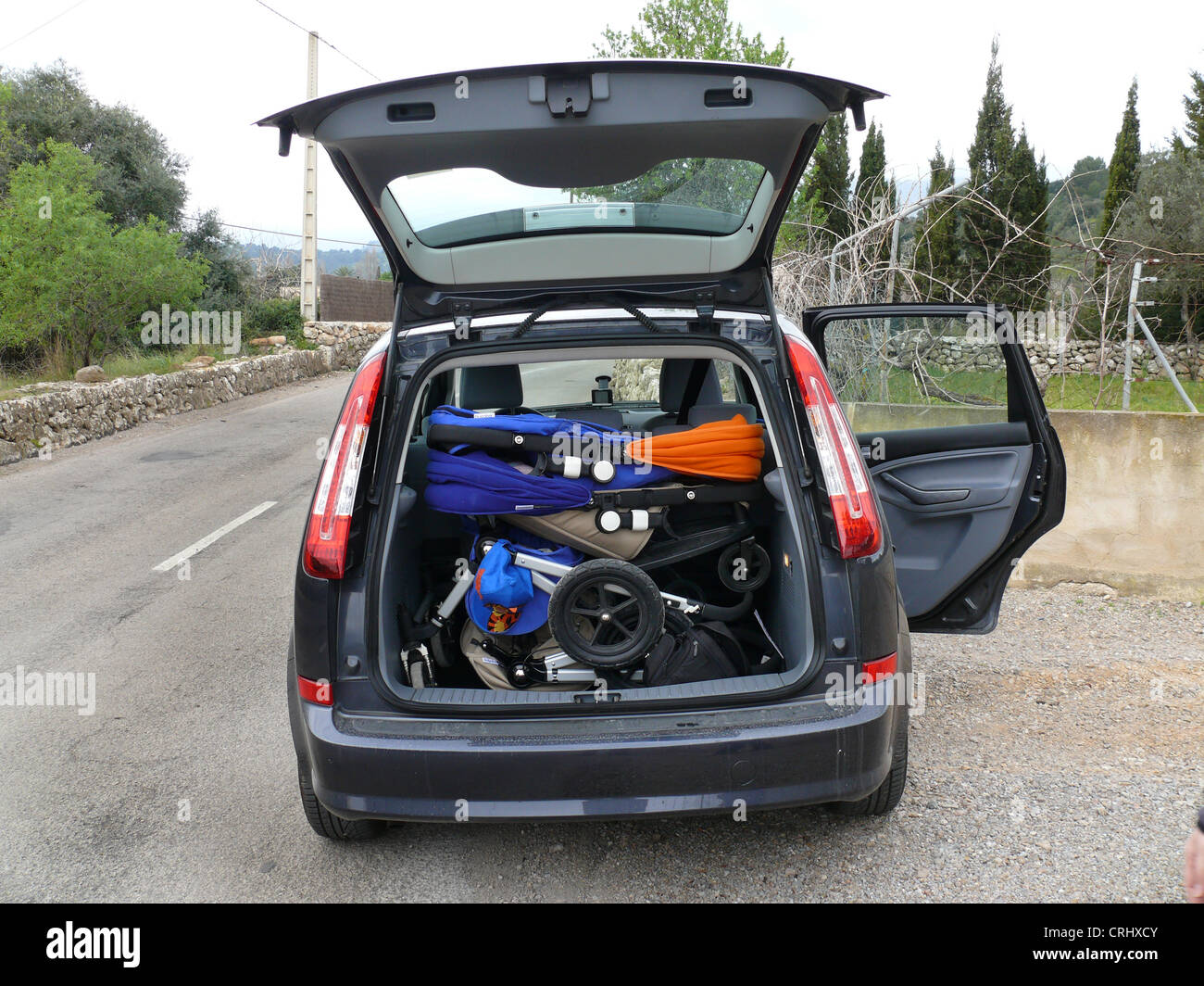 Stroller parking stock photos stroller parking stock images alamy parking hire car with open door and boot lid and two prams inside spain buycottarizona
