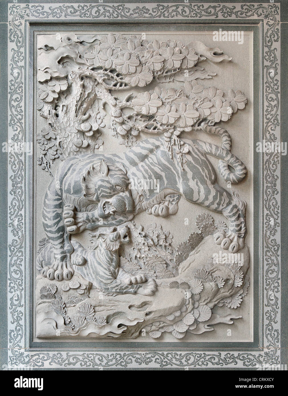 Tiger with cub sculpture relief stone carving outside
