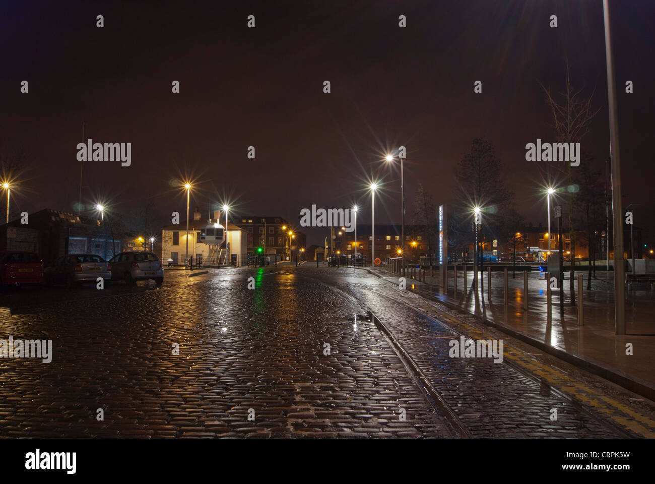 Night shot of wet cobblestone road with glares from lamp in Hull ... for Road Lamp At Night  111bof