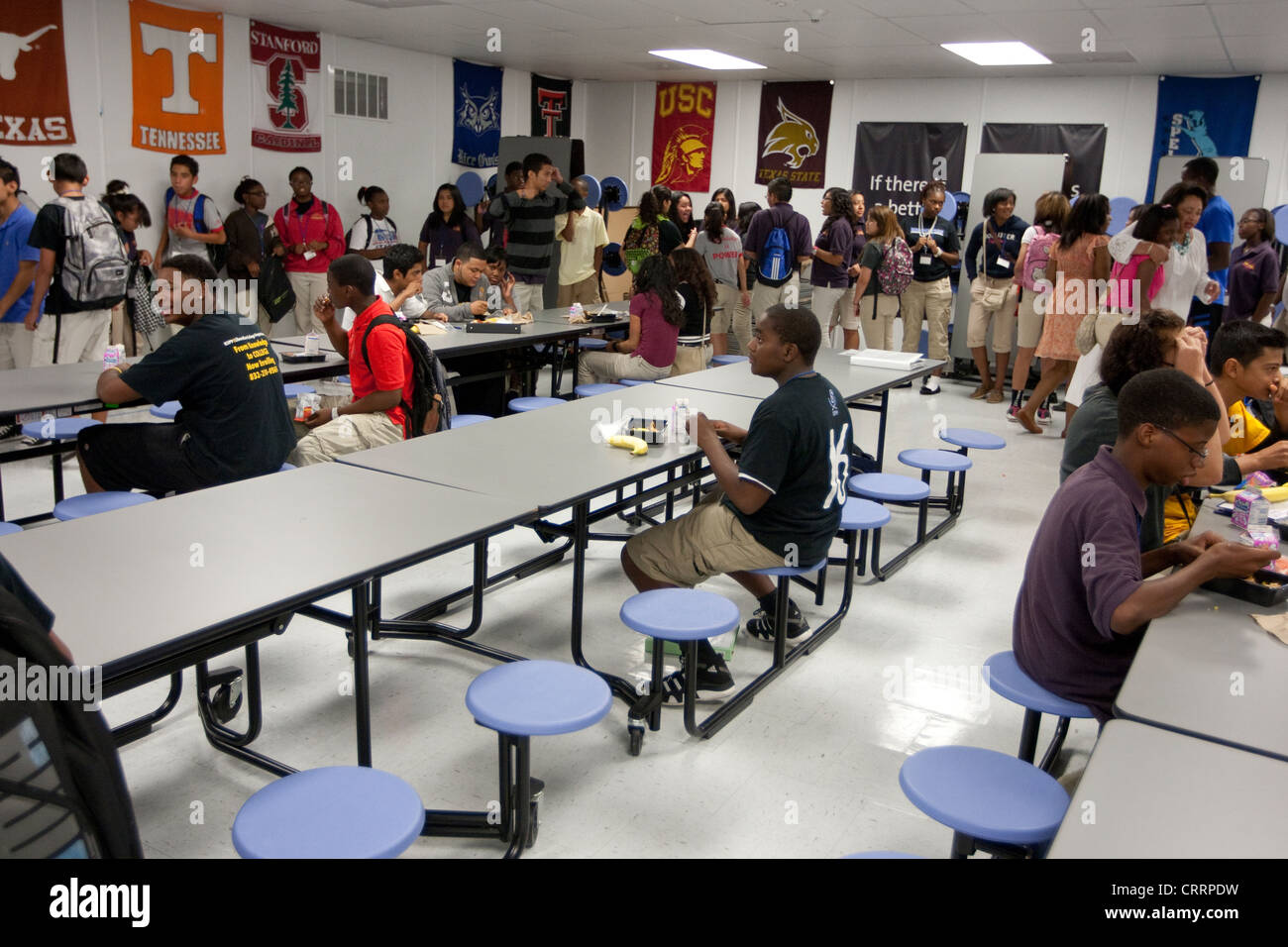 Alone At Table During Lunch In Cafeteria Of Public Charter High School
