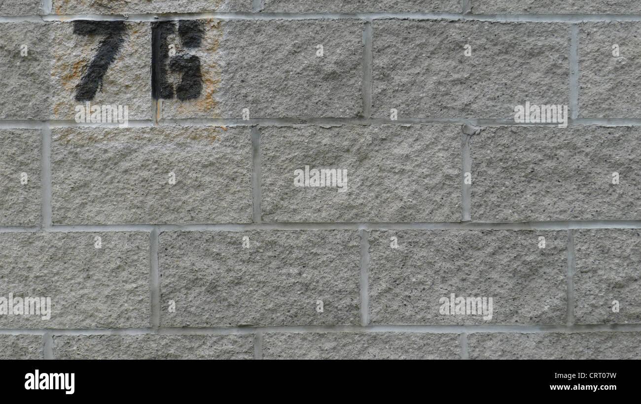 Red Granite New York : Spray stenciled numbers on a granite block wall red hook