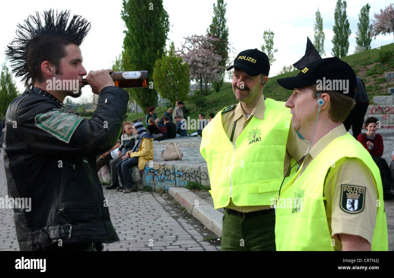 police officers in an interview a punk in the berlin wall police officers in an interview a punk in the berlin wall park