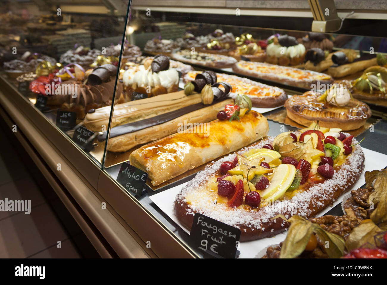 Cakes for sale in a bakery display cabinet in the town of Ceret ...