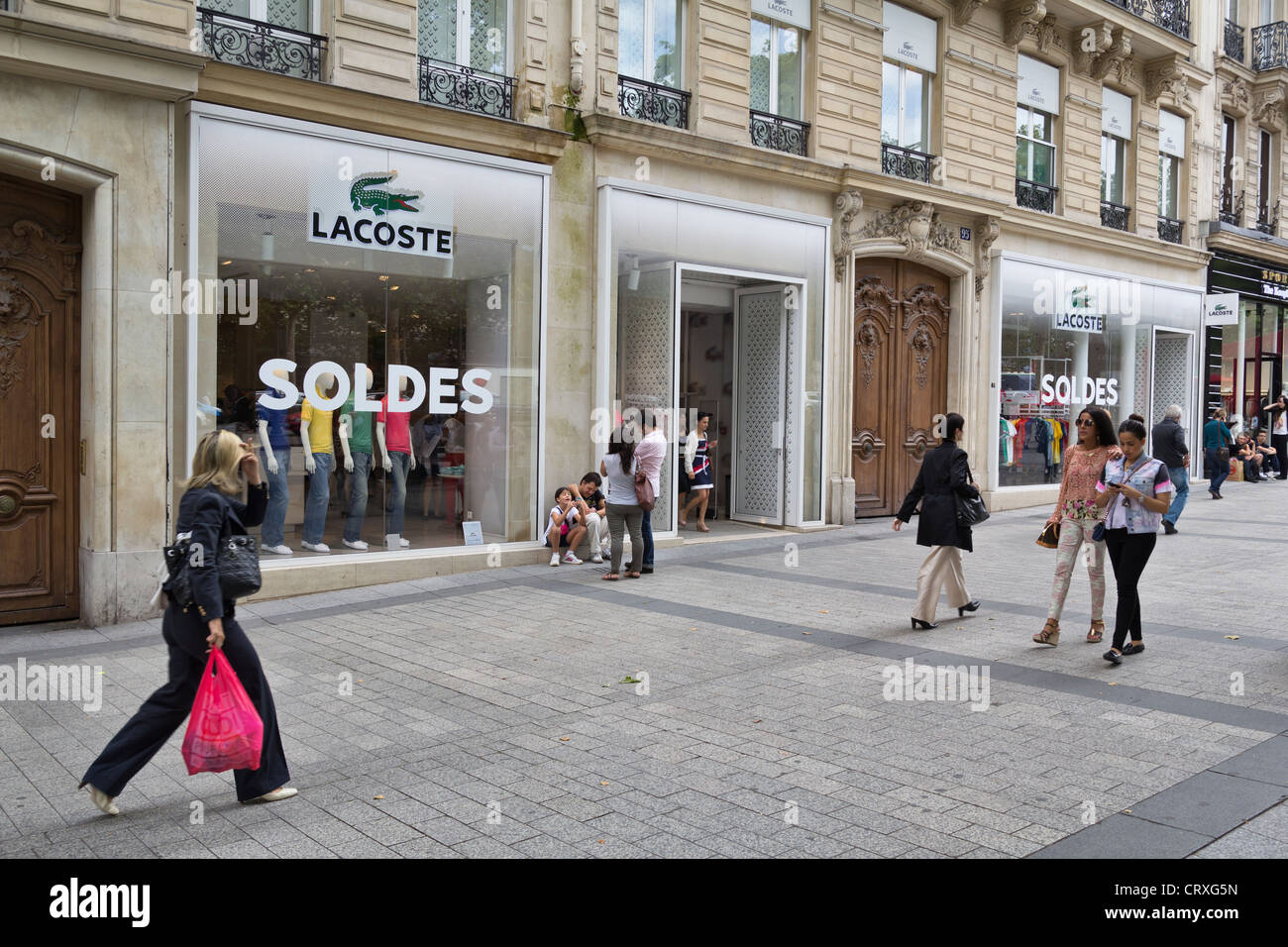 pavement on the avenue des champs lys es in front of lacoste store stock photo royalty free. Black Bedroom Furniture Sets. Home Design Ideas