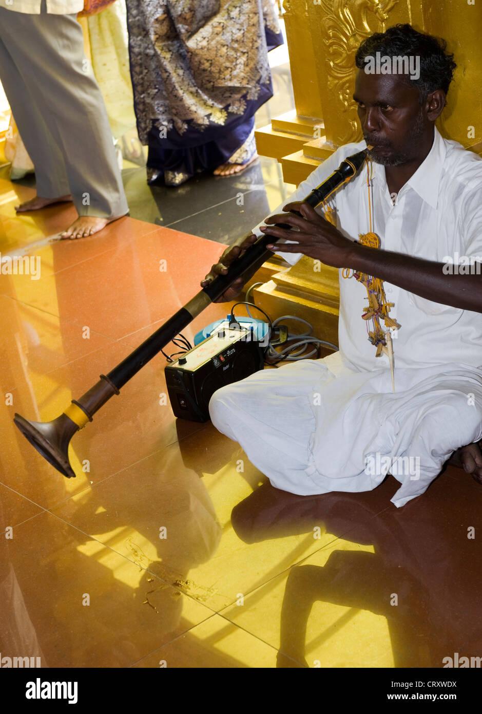 Indian Man Playing A Traditional Shehnai At Wedding In Hindu Temple Kuala Lumpur Malaysia