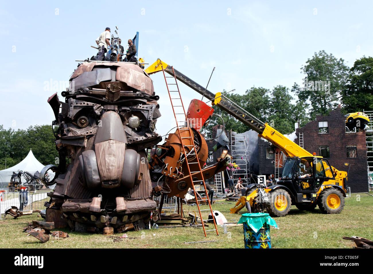 Artists build large sculpture metal head out of scrap car parts at ...
