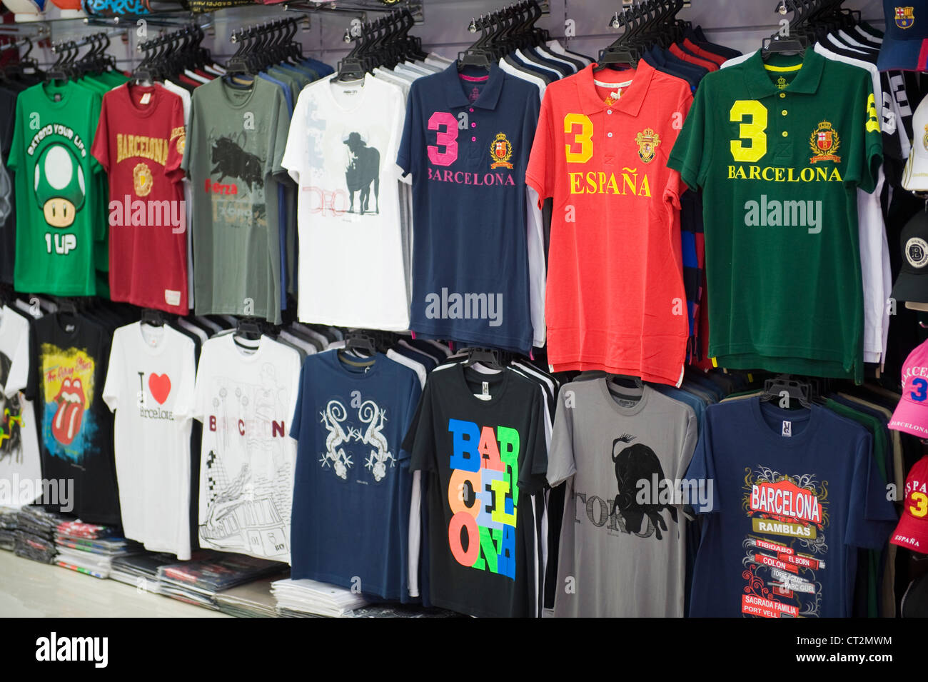 T Shirts Hanging In A Souvenir Shop In Barcelona Stock