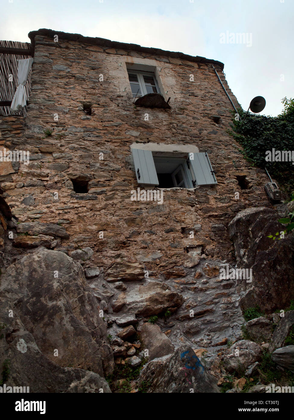 A house built into the side of a mountain in kardamyli House built into mountain
