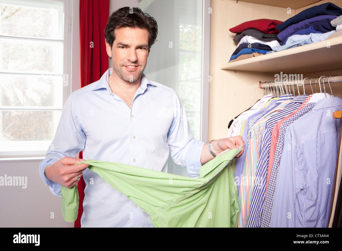Man Hanging Up Clothes In Closet Stock Photo 49246768 Alamy