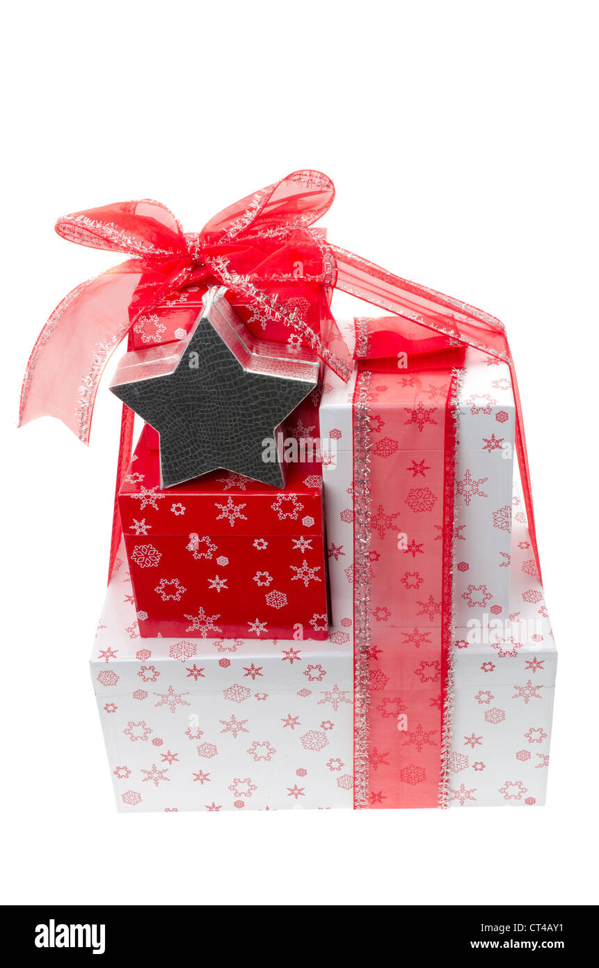 Gift wrapped boxes tied with a red ribbon in a bow studio shot gift wrapped boxes tied with a red ribbon in a bow studio shot with a white background negle Images