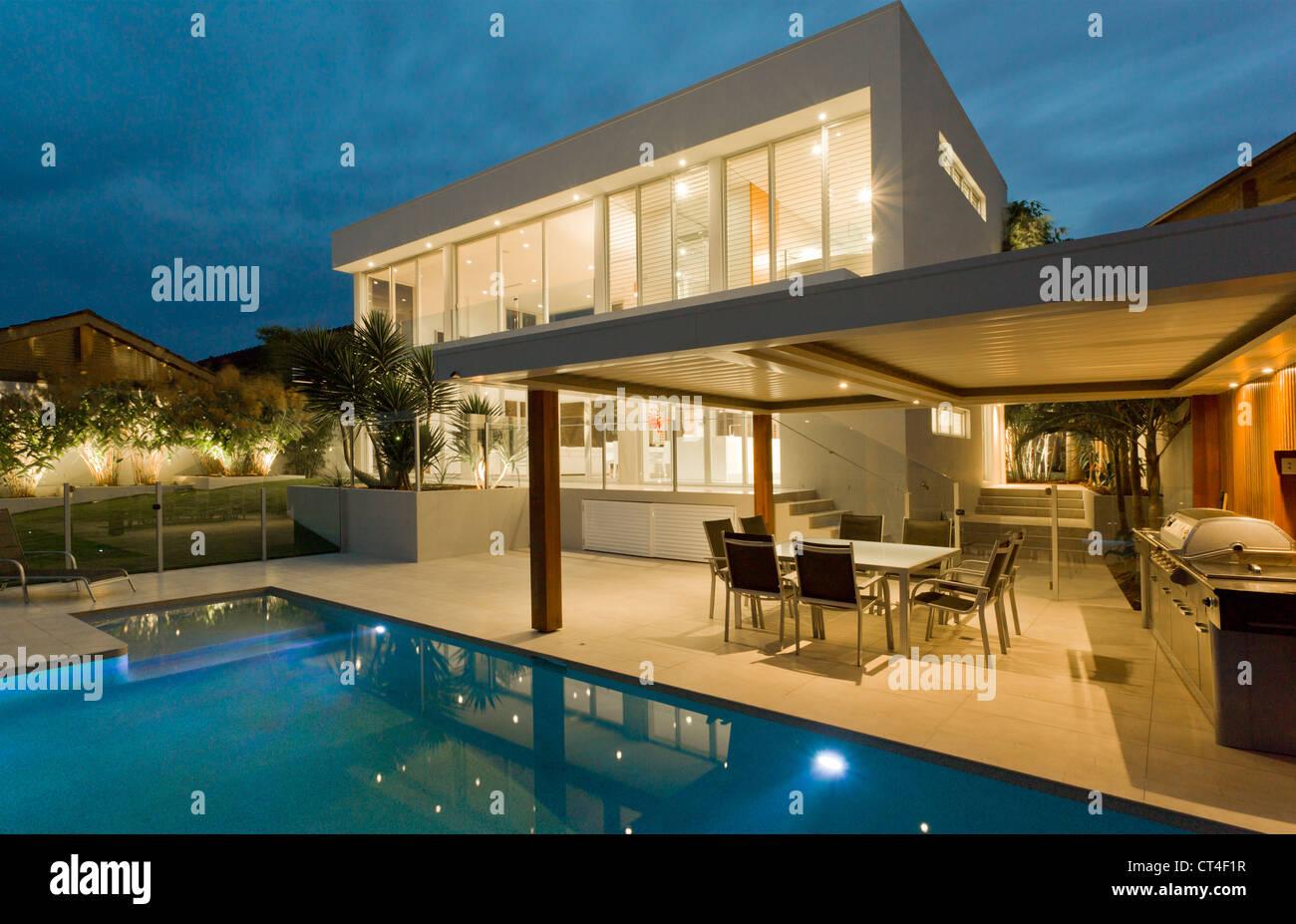 modern backyard with swimming pool in australian mansion stock